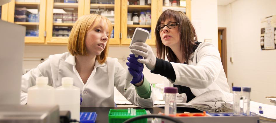 Two female students working in a laboratory