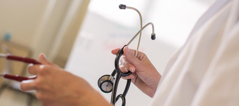 Close up of a doctor holding a stethoscope